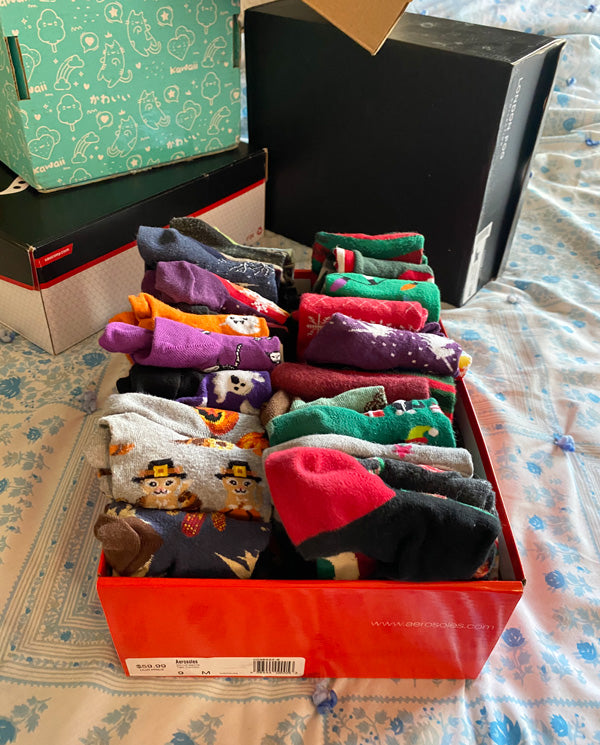 Socks organized into rows inside shoeboxes