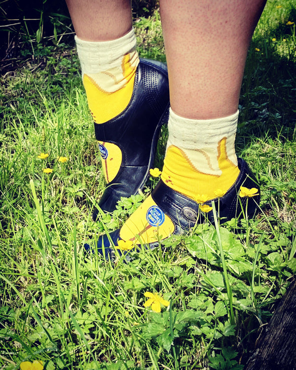 Cute banana socks with peels and blue banana sticker design, and non slip grips