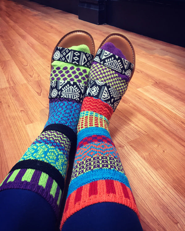 Fun mismatched socks worn with sandals