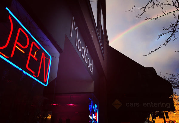 Our sock store in Bellingham, WA with a rainbow in the sky