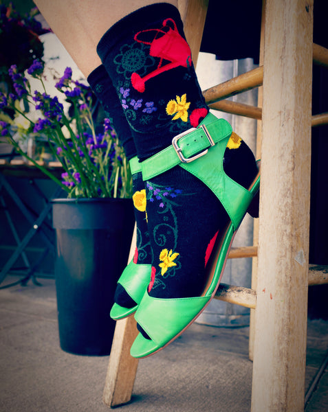 Colorful floral socks worn with green sandals