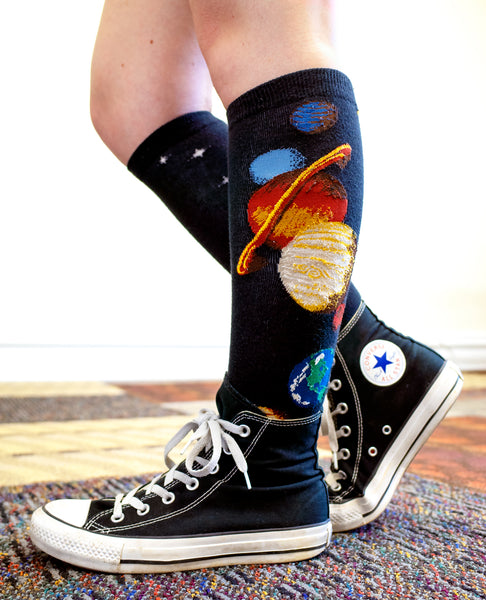 67c4a175015 Wearing black Chucks and planet knee socks