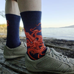 Kraken socks for men by ModSocks with a giant red squid lurking in the depths of the ocean.