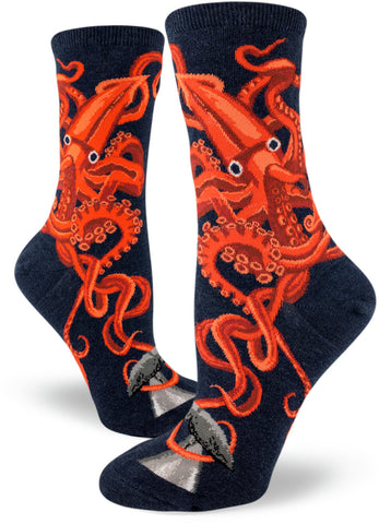 Squid socks for women featuring giant orange-red squids on a navy sock.