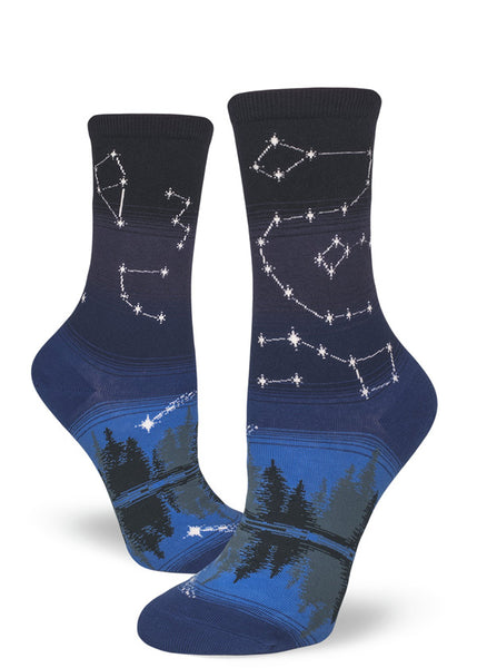"Constellation socks with stars on a striped night sky background, as worn by Hilary Swank in the Netflix series ""Away."""