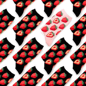Strawberry socks with red strawberries on a pink or black crew sock.