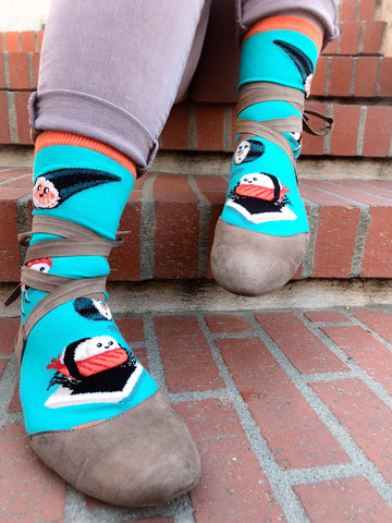 Anthropomorphic cute sushi play on a teal background on these women's crew socks by ModSocks.