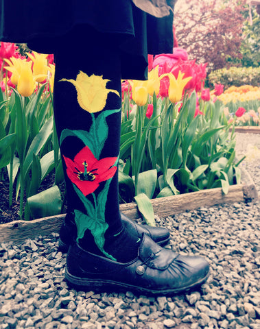 Tulip knee socks with tulip flowers in the background