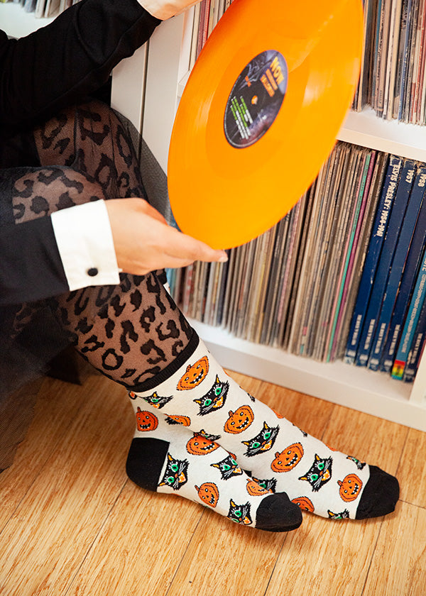 Vintage Halloween socks with retro-style cats and pumpkins