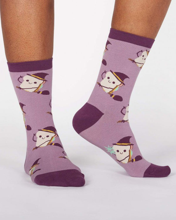 Sandwich witch socks with sandwiches flying on broomsticks