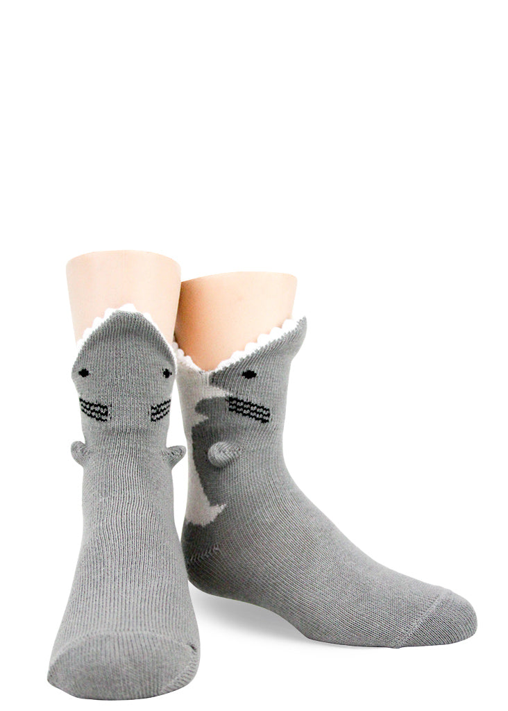 Funny 3D shark socks for kids make it look like a shark is eating your foot!