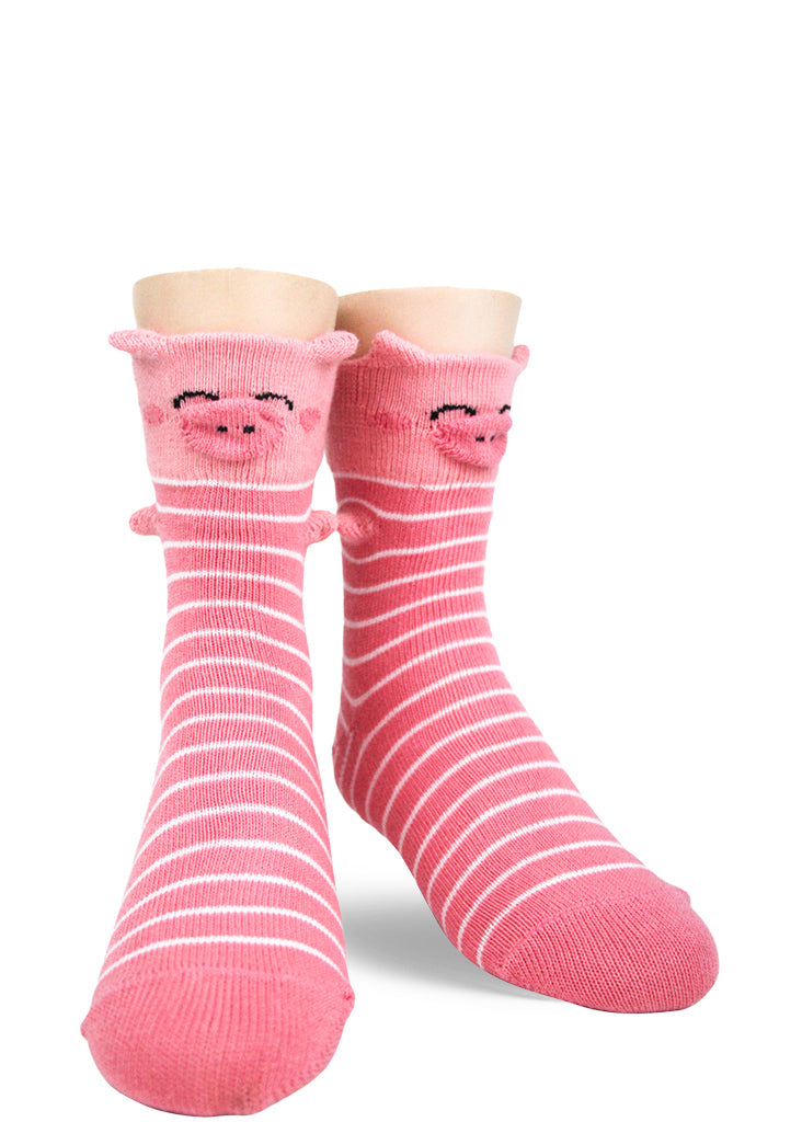 Striped socks for kids make each foot look like an adorable pink pig with 3-D snout, nose, and trotters!