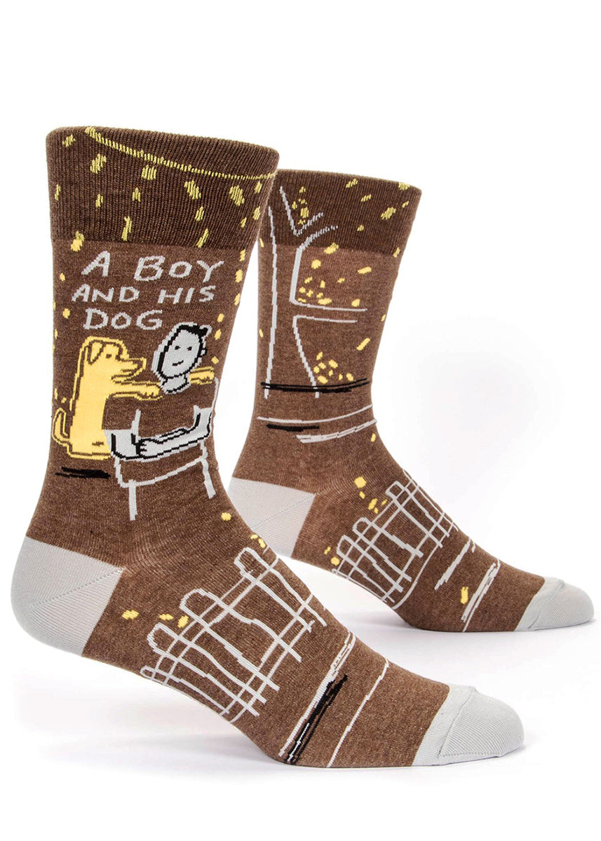 "Dog socks for men with the words ""A boy and his dog"" with a man and dog on a brown background"