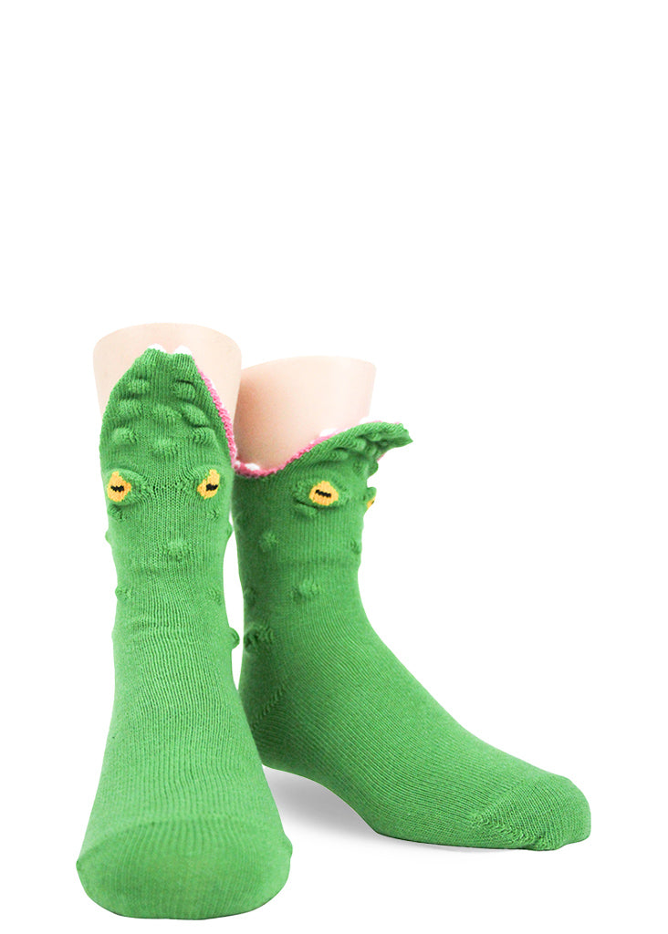 Green alligator socks for kids in 3D look like they are eating your feet!