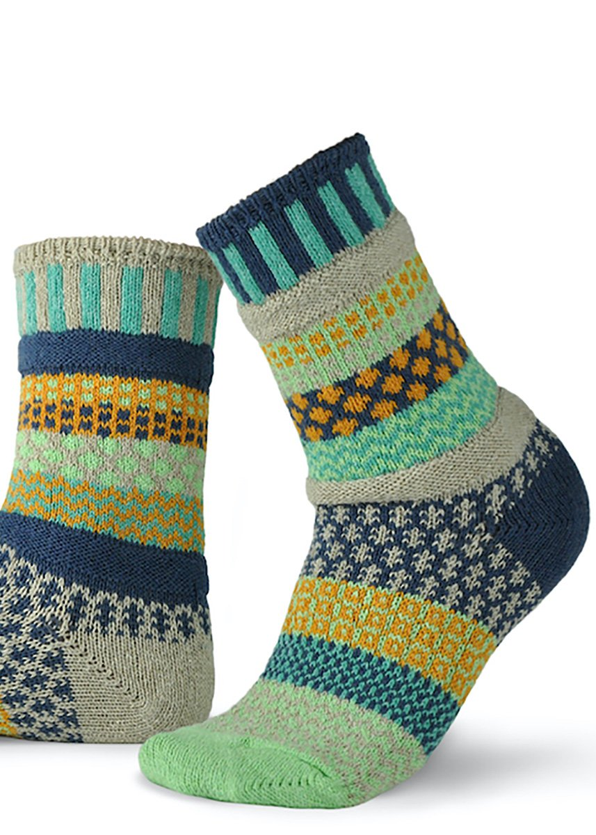 Cozy mismatched pattern socks with shades of dark blue, aqua, mustard yellow, and light gray.