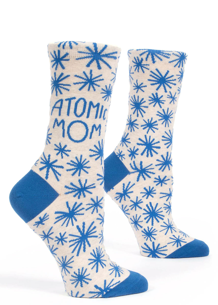 "Atomic Mom socks for women with blue starbursts on a white background and the words ""Atomic Mom"""