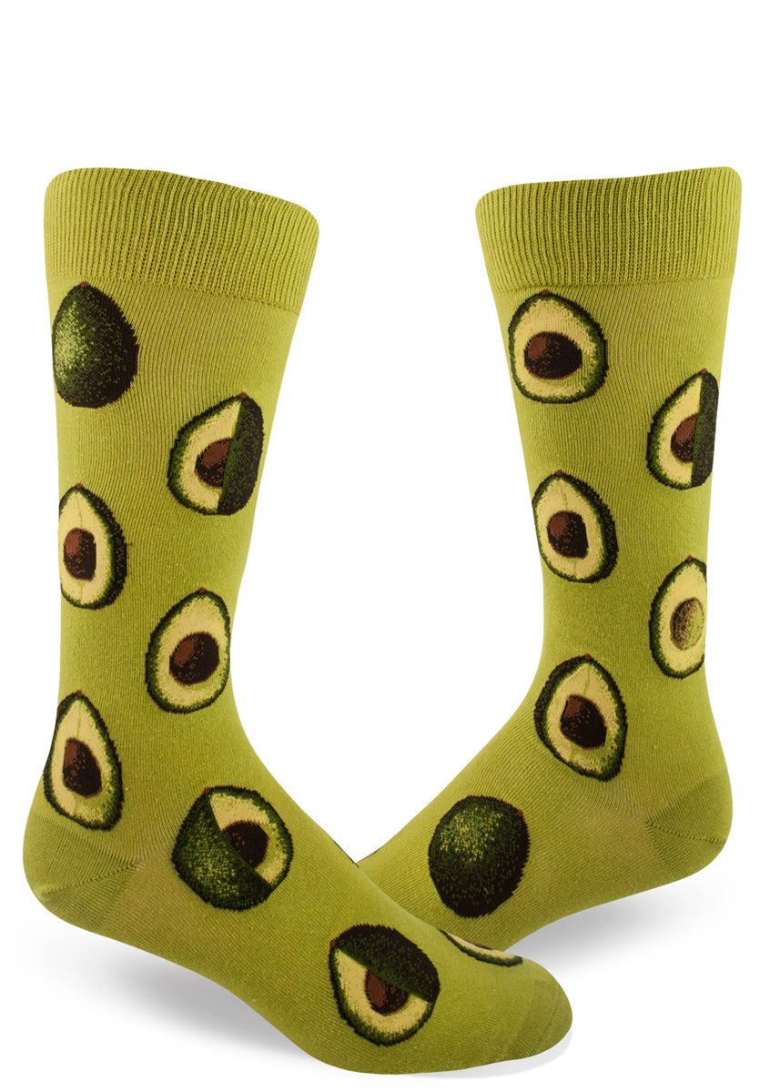 Avocado socks for men with avocados sliced in half on a green background
