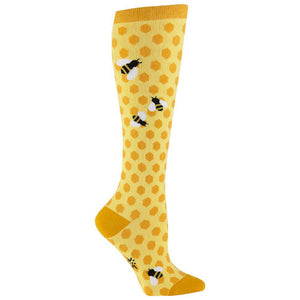 Bees busily buzz against a honeycomb background on these golden knee high socks.