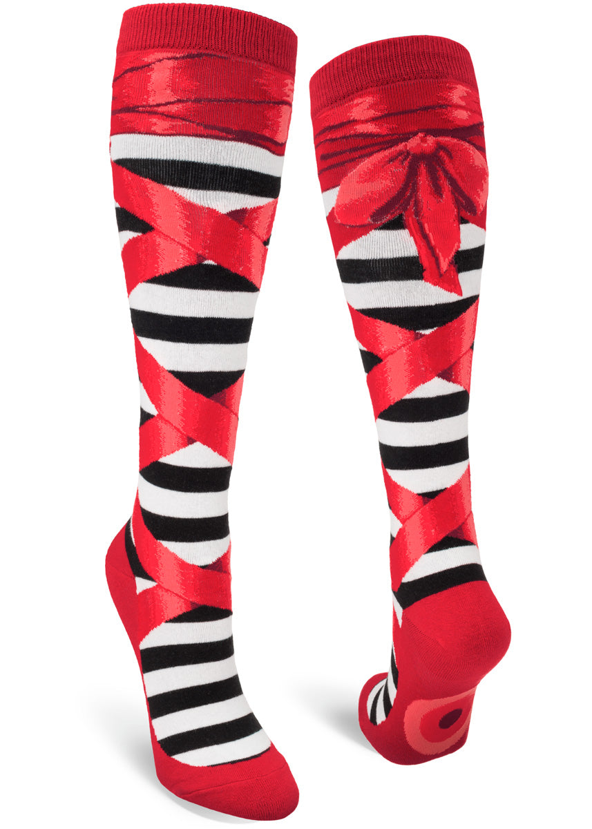 Knee high socks for women outfit your legs in ruby red ballet slippers with red ribbons tied up to the knee!