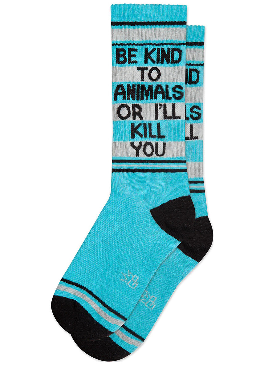 "Funny unisex gym-style socks say ""Be kind to animals or I'll kill you"" on a light blue background with silver stripes."
