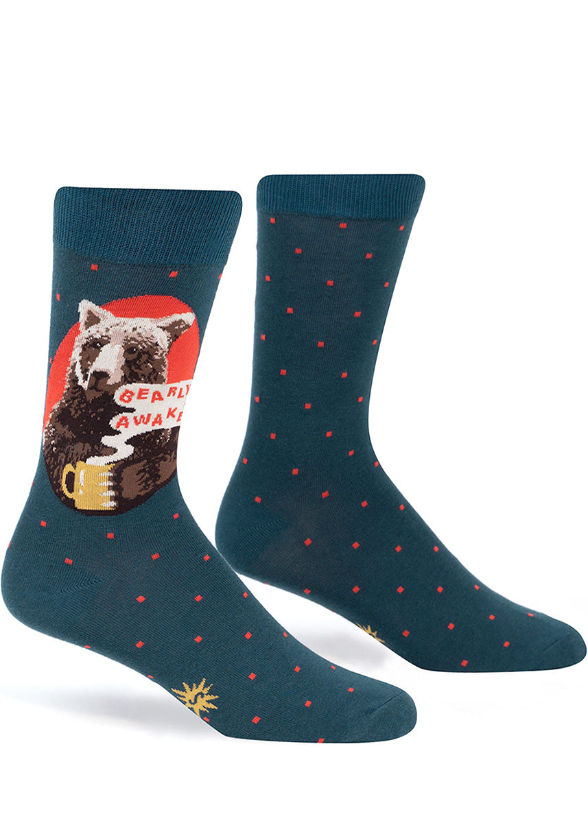 "Funny crew socks for men show a grizzly bear with a mug of coffee and the words, ""Bearly Awake."""