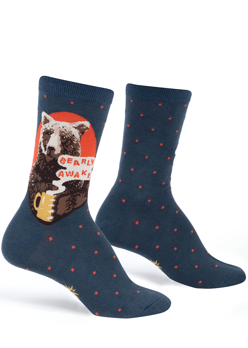 "Funny crew socks for women show a bear with a mug of coffee that says ""Bearly Awake."""