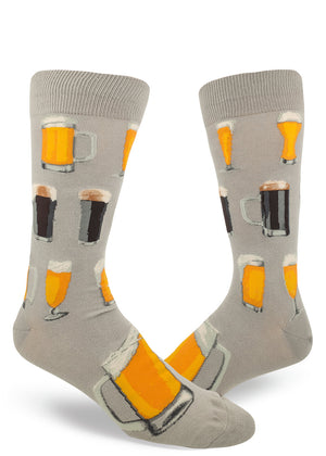 Beer socks for men with dark brown beer and amber beer in different shaped beer glasses on a gray background