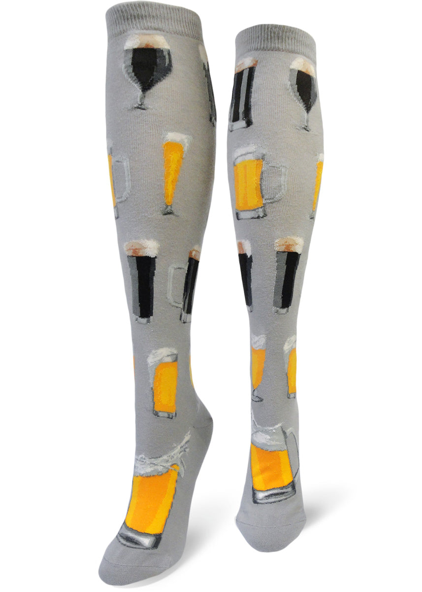 Beer socks for women with light and dark beer in different beer glasses, on a gray background in knee-high link