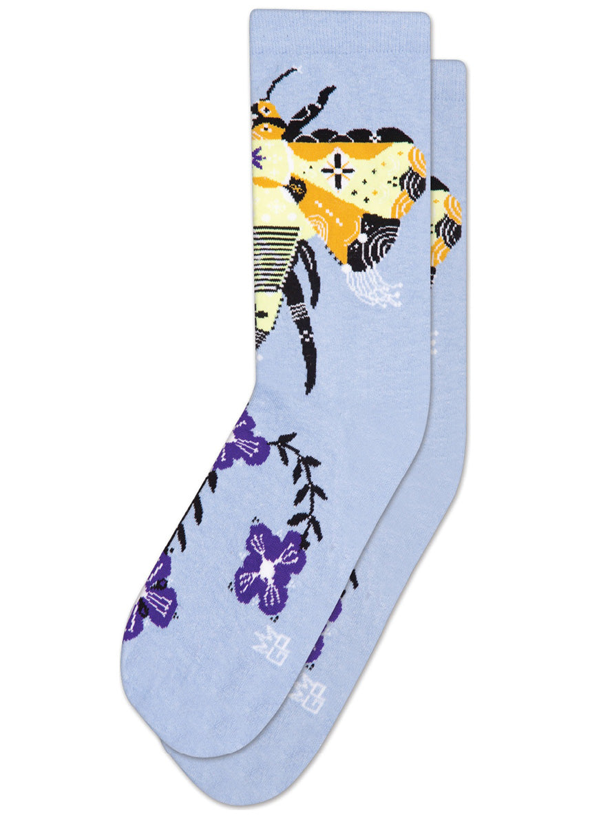 Unisex crew socks feature a stylized bee and purple flowers on a pale blue background.