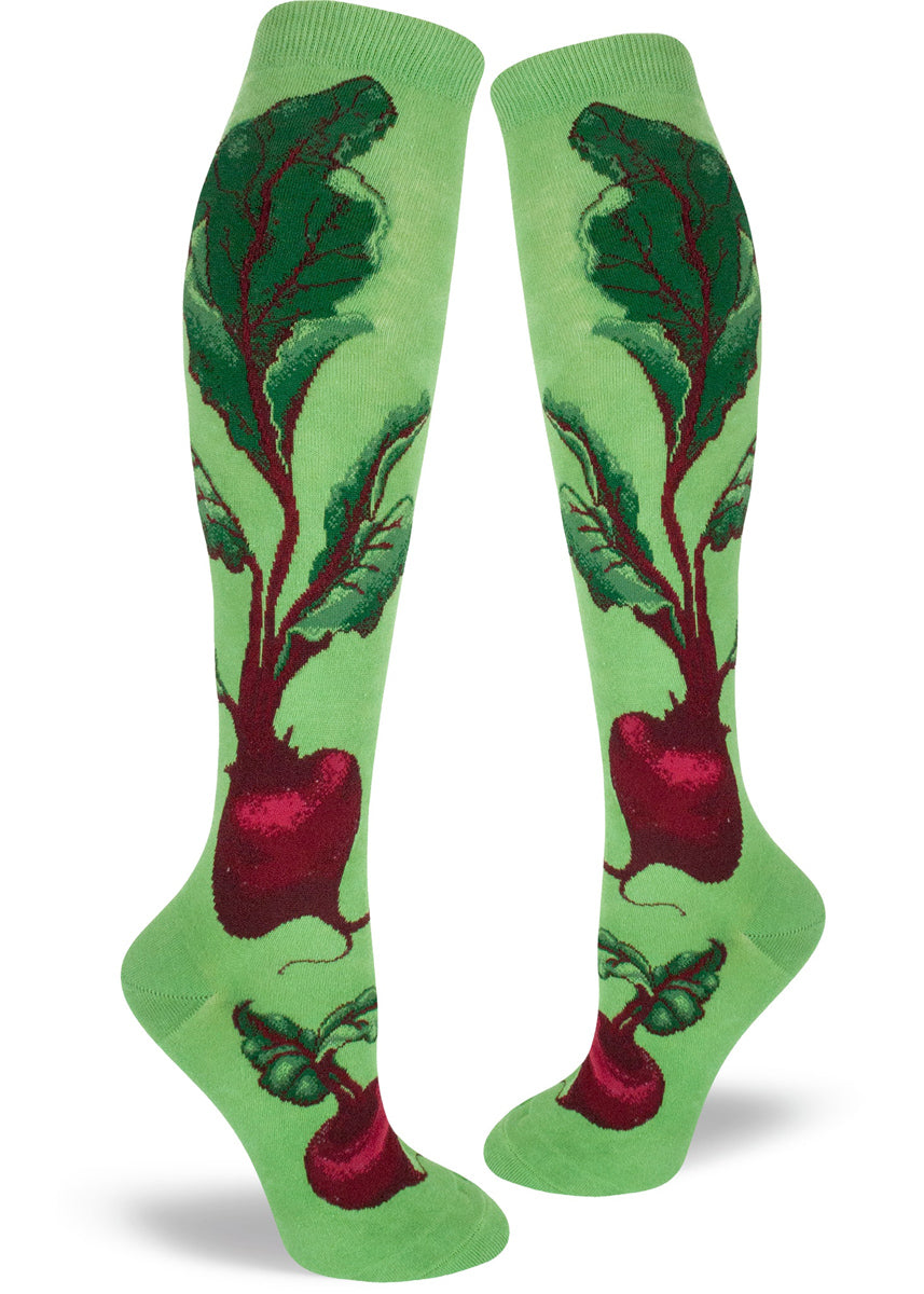 Beet vegetable socks for women with red beets and dark green foliage on a green knee-high