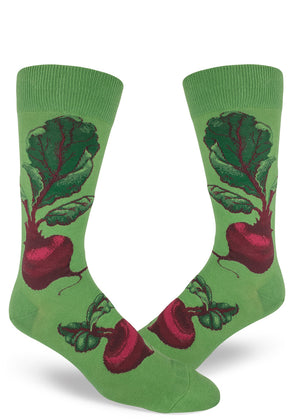 Beet socks for men with red beets and their leaves on a green background.