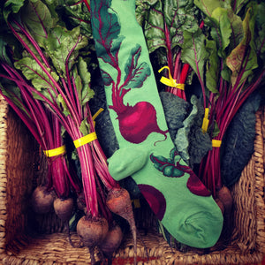Red beets on a green knee sock — the perfect socks for a Saturday at the farmers market.