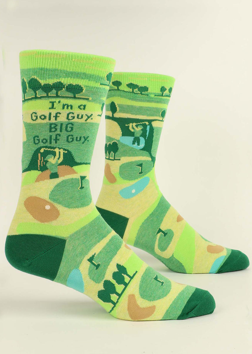 "Funny golf socks for men show a hapless golfer hitting the course with the words, ""I'm a golf guy. BIG golf guy."""