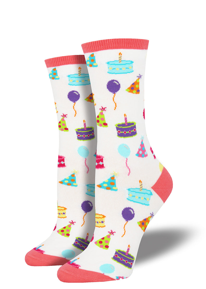 Cute socks for women with birthday cakes, colorful party hats & balloons.