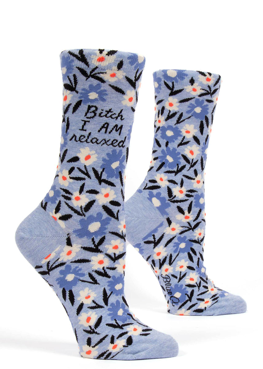 "Bitch socks for women that say ""Bitch I AM Relaxed"" with a blue floral pattern"