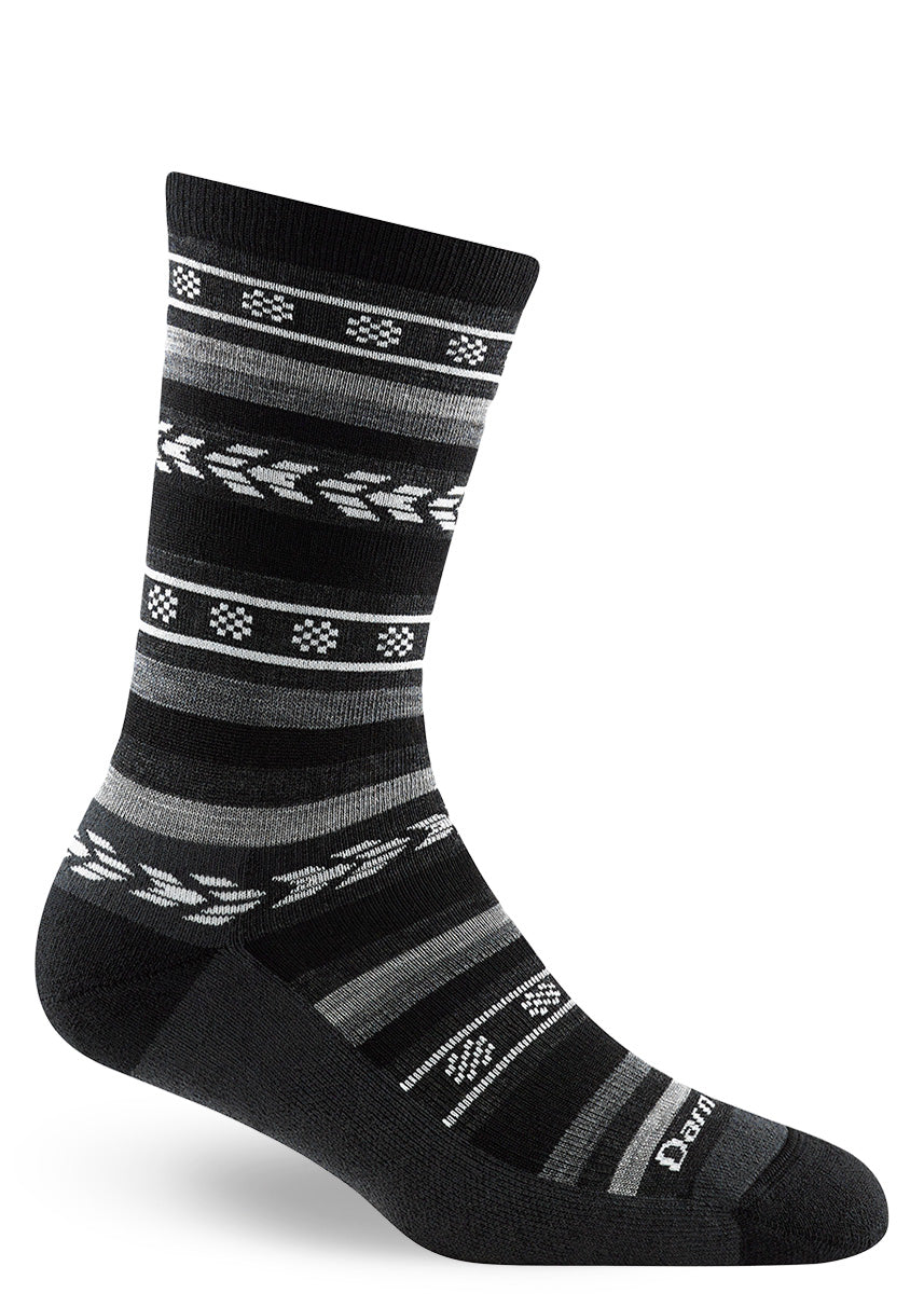 Wool socks for women feature a white and gray patterned stripe design on a black background.