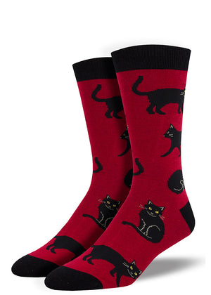 Black cat socks for men with cats with yellow eyes on a dark red background