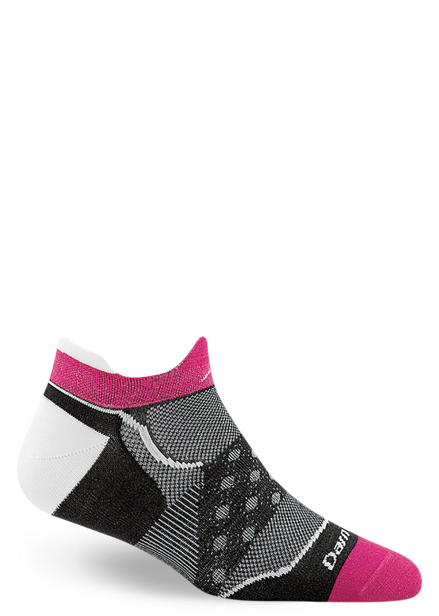 Wool running socks for women come in an ankle length and are black and white with hot pink accents.