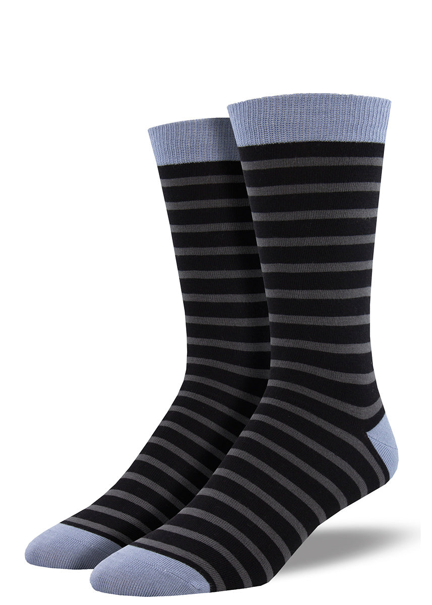 Bamboo socks for men feature gray and black stripes with light blue toes, cuffs, and heels.