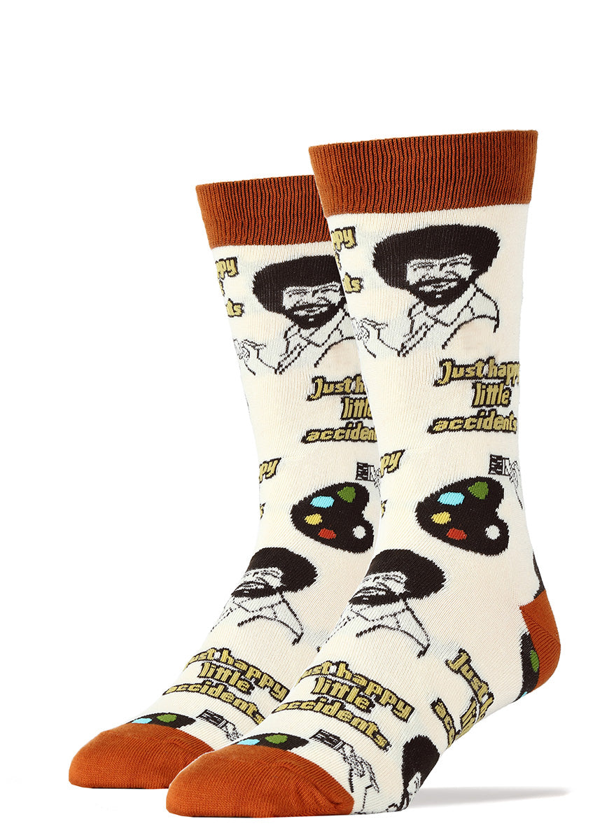 "Bob Ross socks for men with painter's palettes and the words ""just happy little accidents."""