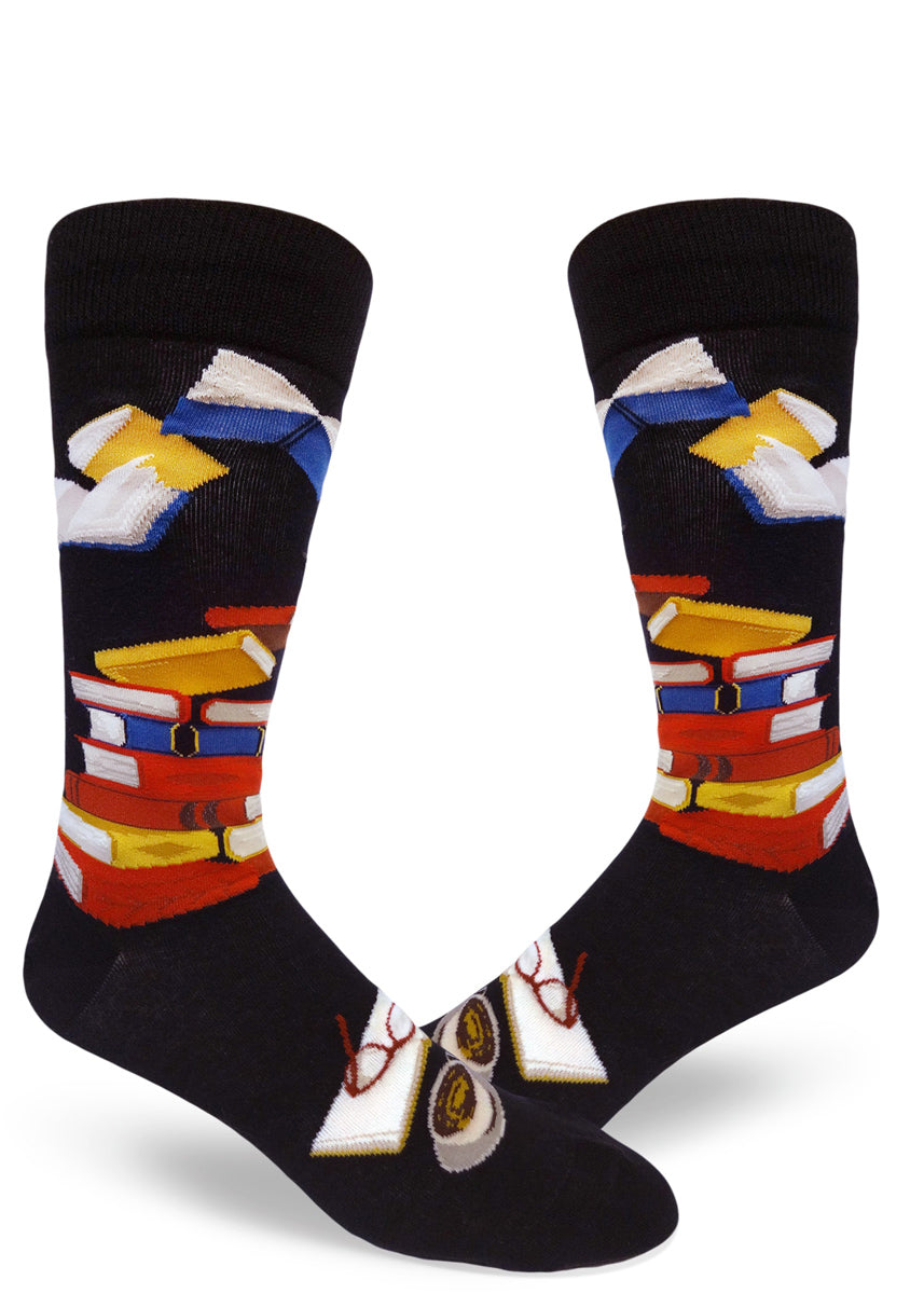 Book socks for men with books in different colors stacked up, a book being read and books flying through the air
