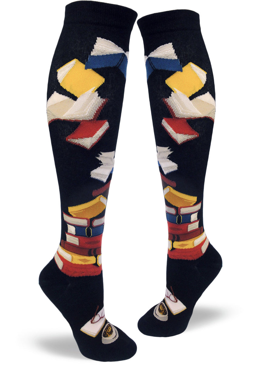c1f54e19ef6 Knee-high book socks for women with stacks of books