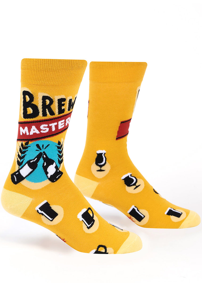 "Funny beer socks for men show steins of beer and bottles clinking with the words, ""Brew Master."""