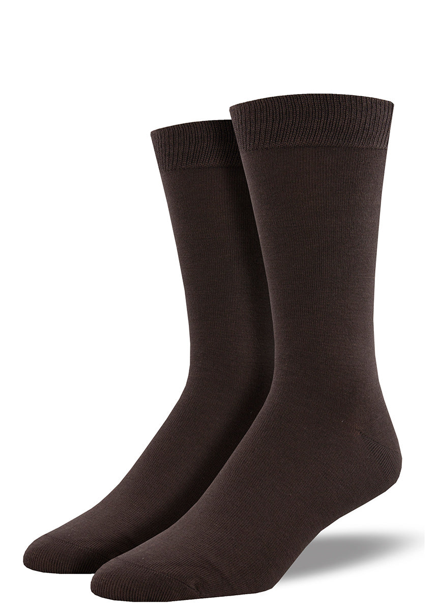 Solid dress socks for men come in a dark brown and are made of super soft bamboo.