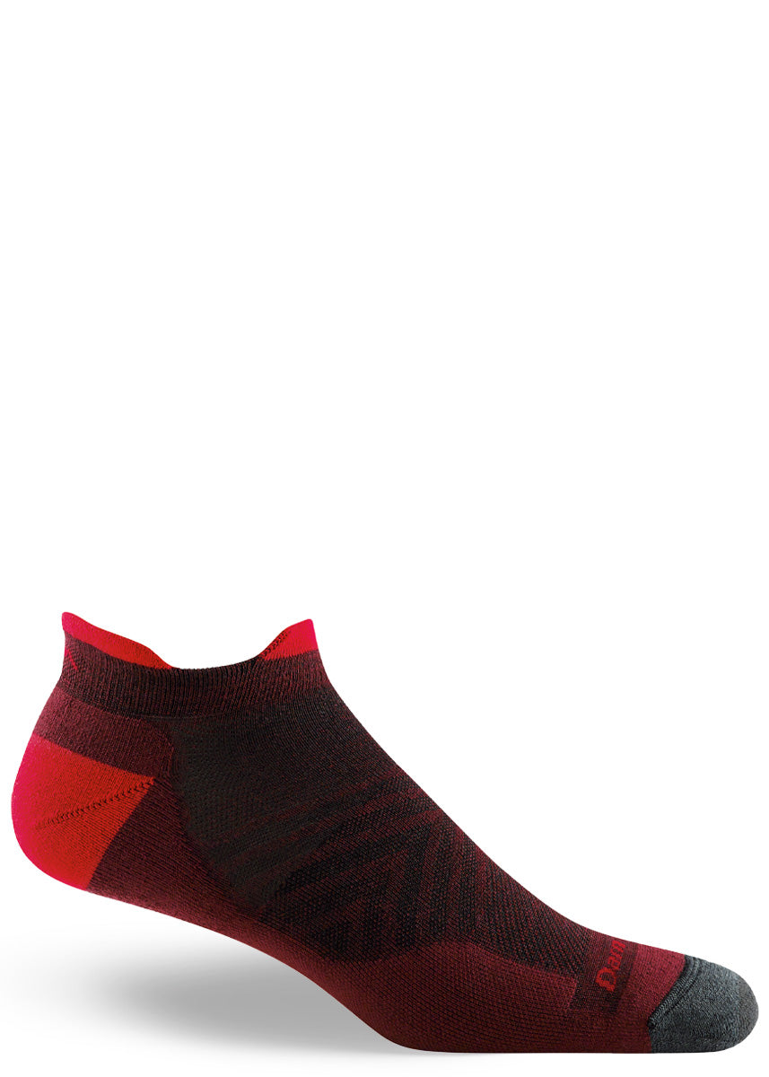Wool running socks for men feature a lightly cushioned ankle-length design of burgundy, red, and charcoal.