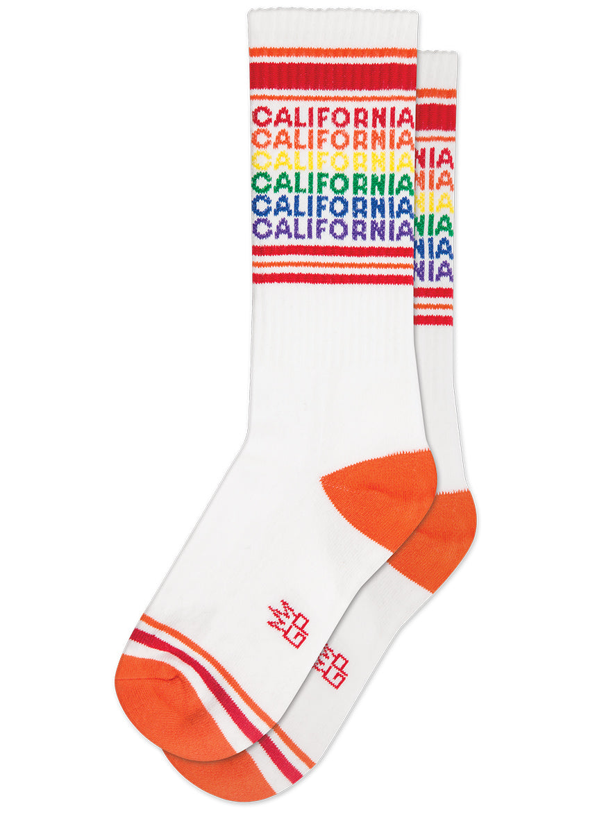 "California socks repeat the word ""CALIFORNIA"" in rainbow lettering on white & orange retro-style gym socks for men & women"