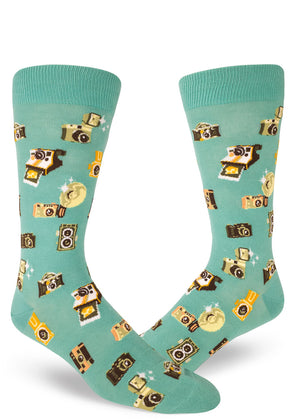 Camera photography socks for men with vintage cameras taking photos and Polaroids on a dusty turquoise background