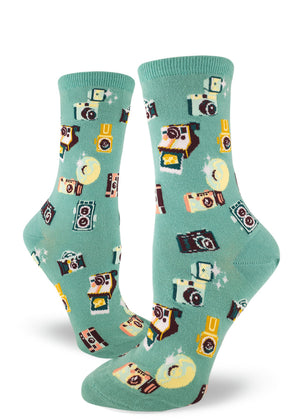 Cute camera socks for women with vintage cameras flashing and printing Polaroids on dusty turquoise background