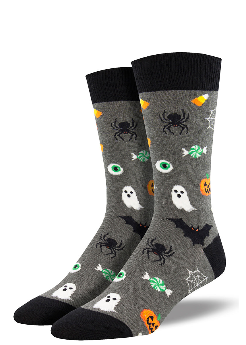 Spooky Halloween socks for men feature candy corn, spiders and spiderwebs, bats, ghosts, and jack-o'-lanterns!