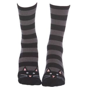 Cute slipper socks for women with cat faces on the toes and non-slip grippers on the bottom.